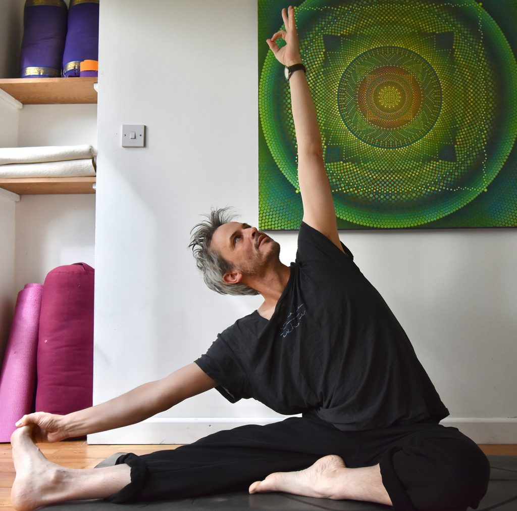 image of James Russel in a Yoga pose